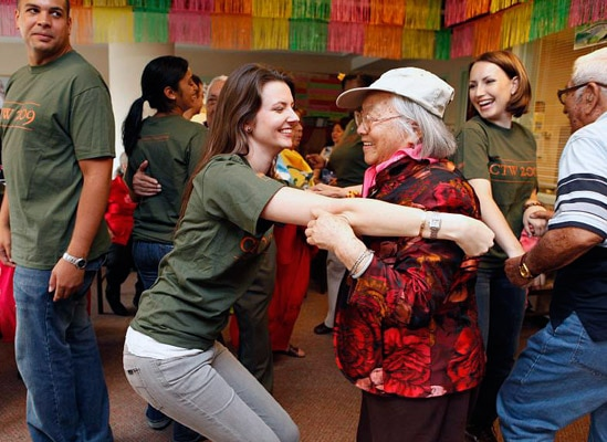 Young people dancing with seniors