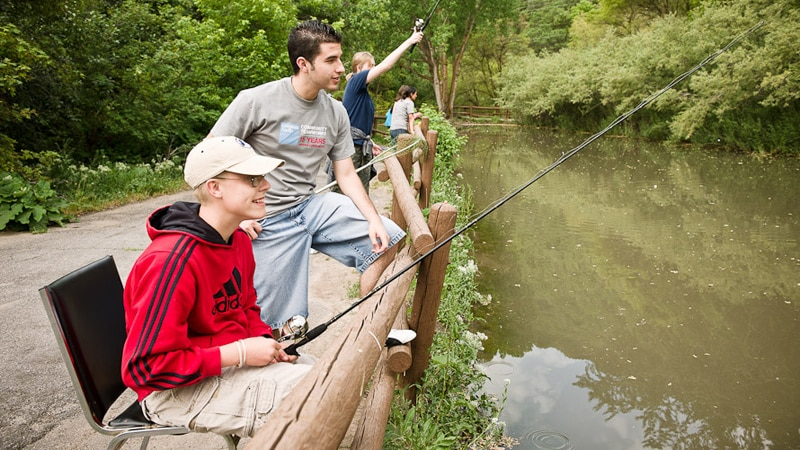 Four people fishing in a river